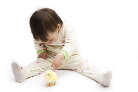 isolated little girl with easter chicken