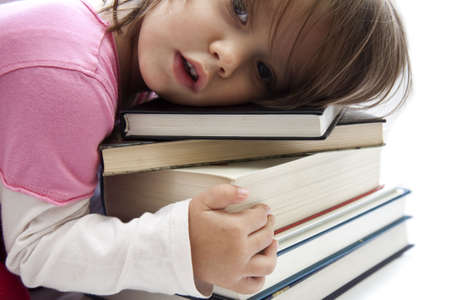 Cute little girl hugging the books