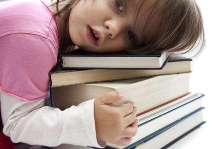 Cute little girl hugging the books