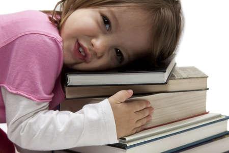 Little girl huga  tower of colorfull isolated books