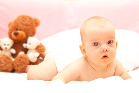 Little beauty baby girl with a teddy bear photo