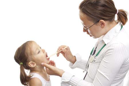 Examination - sick girl showinh het throat to the doctor