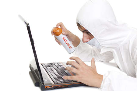 antivirus spray  - desinfecting your computer concept Stock Photo