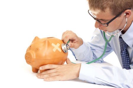 Crisis time - sick piggy bank and a doctor