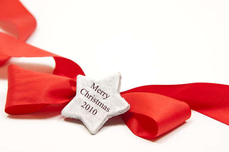 isolated red ribbon for any occasion with a silver star photo