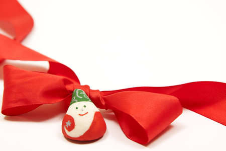 isolated red ribbon with a handmade santa for christmas decoration Stock Photo - 8155218