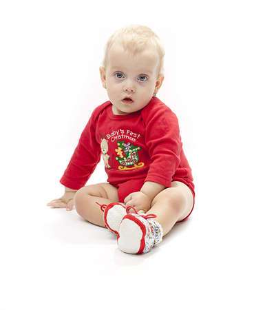 baby`s first christmas - isolated little girl in a red body  photo