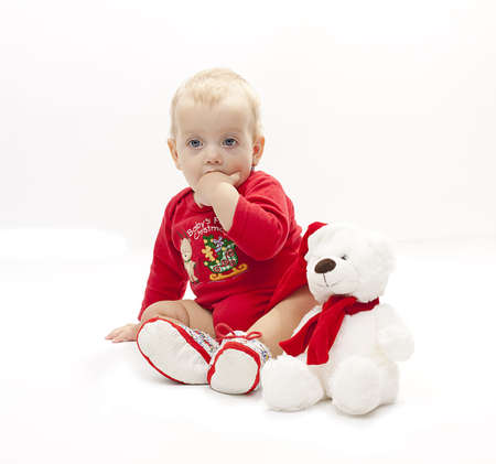 isolated little girl in a red body with her white bear  photo