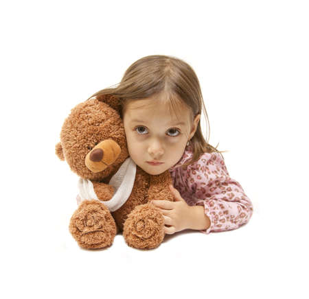 broken arm - isolated teddy bear with her little friend photo