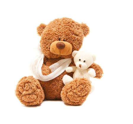isolated teddy bear with a broken arm, wit her baby Stock Photo