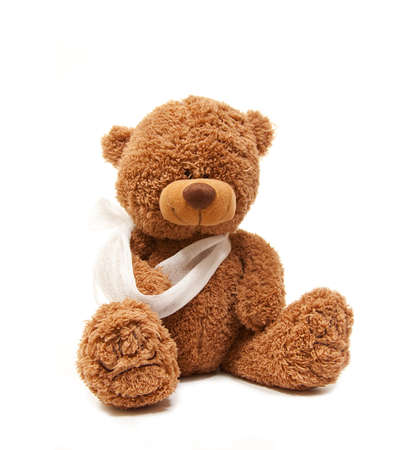 isolated teddy bear with a broken arm photo