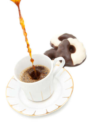 a cup of coffe with chocolate cookies