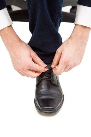 business men tie him shoelace