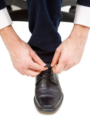 Business Men tie ihn Schnürsenkel