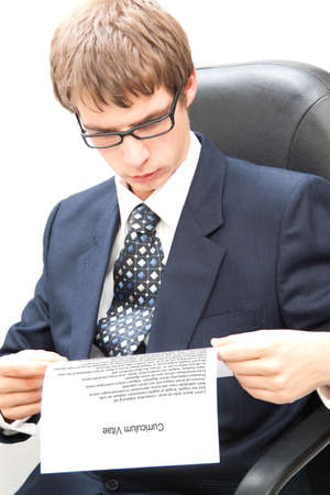 Yuoung business man reading a curriculum vitae Stock Photo