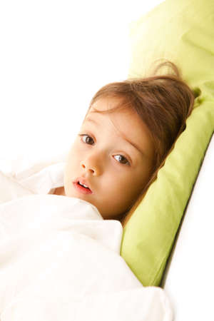 sick little girl on bed with Stock Photo