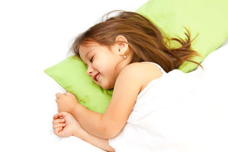cute little girl smiling in her bed