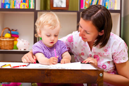 babysitter: mother teaching to draw hwr daughter