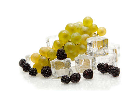 frozen solid: isolated fresh fruits with ice cube Stock Photo