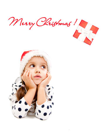 cute little girl dreaming about christmas present photo