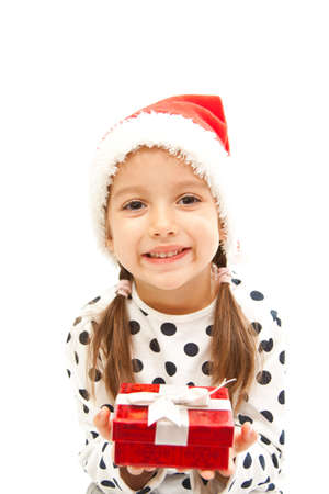 smile christmas girl holding a red gift box photo