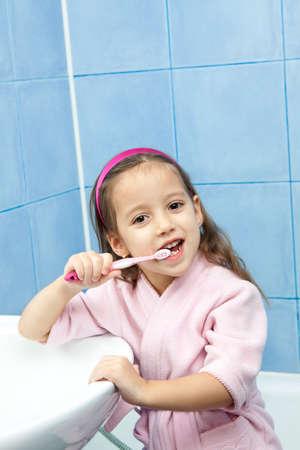 girl teeth: smile girl washing her tooth in tha bathroom
