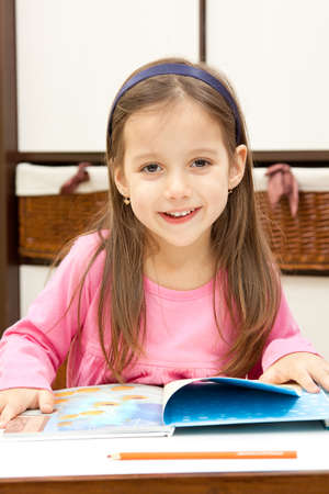 student girl: smile little girl learning - back to school concept