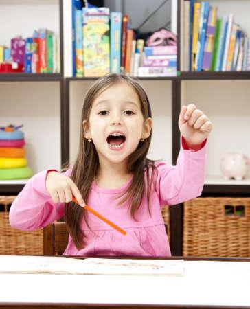 happy preschool girl in her room readdy for back to school