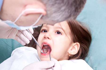 little girl have a dental control