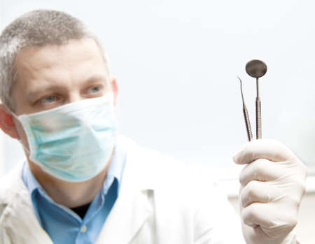 stomatologic tools in a doctor hand Stock Photo