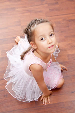 little ballerina poseing to the camera photo