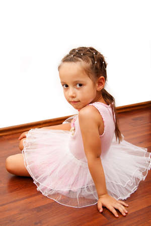 little girl in ballerina dress, laying on  the floor Stock Photo