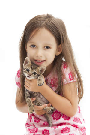 smile girl holding an adorable cat Stock Photo