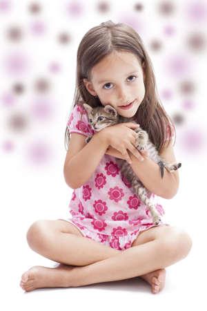 little kitten in a smile girl hand