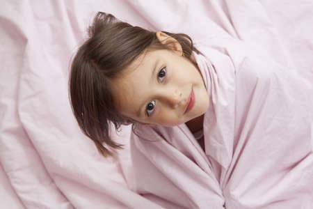child in bed: morning time - happy girl in bed with pink pillow