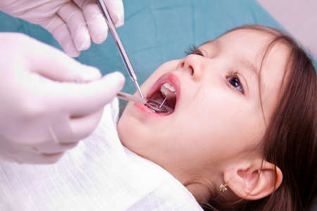 little girl have a dental control photo