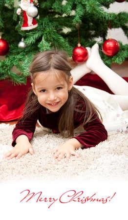 smile girl under the christmas tree Stock Photo - 15921973