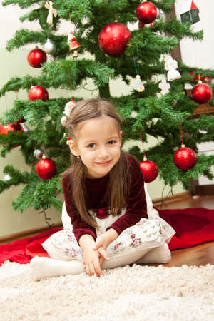 smile girl with christmas tree photo