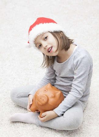 christmas and piggiy bank - concept photo