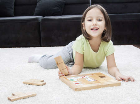 memory game - little girl playing on the floor