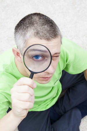 trough: man looking trough a magnify glass
