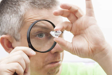 loupe: Jeweler looking intrigued at a diamond