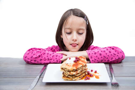 flapjacks: delicious pancake, little girl have breakfast