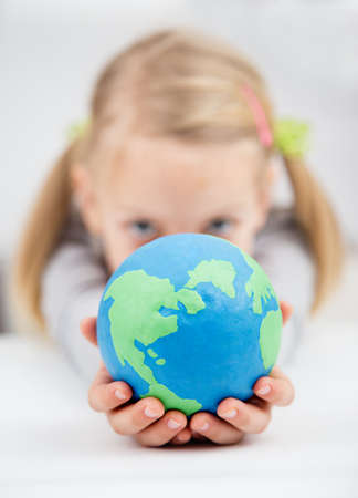 little girl holding the earth globe