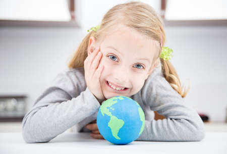 smile girl with clay earth globe Stock Photo