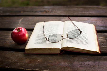 reading time, autumn feeling, with red apple