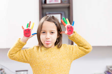 cute girl have fun with colored hand Imagens