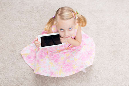 cute blonde girl with her tablet