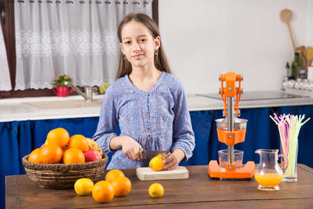 cute girl make an orange juice