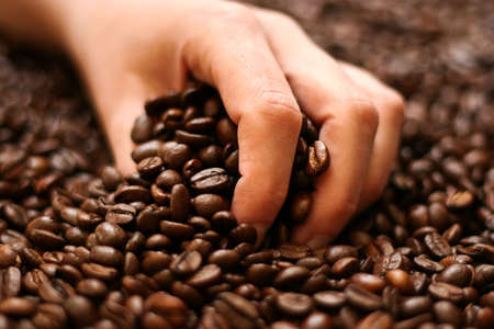 Women hand holding coffee beans background photo